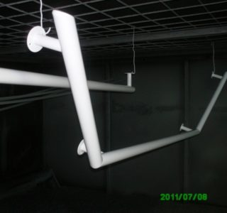 Hand rails, weld brackets and cure in oven
